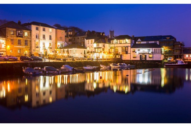 Custom House quay harbour Falmouth at Dusk on a foggy evening. Cornwall England UK Europe