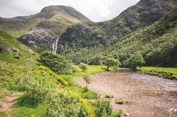 The Water of Nevis in the Highlands spills out on to a flat valley bed