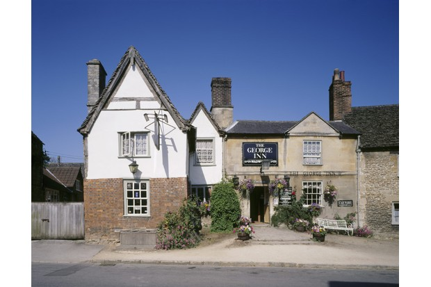 View of The George Inn in West Street in Lacock Village which holds one of the longest continuously held licences in the West Country. The Inn was renamed at the time of King George II.
