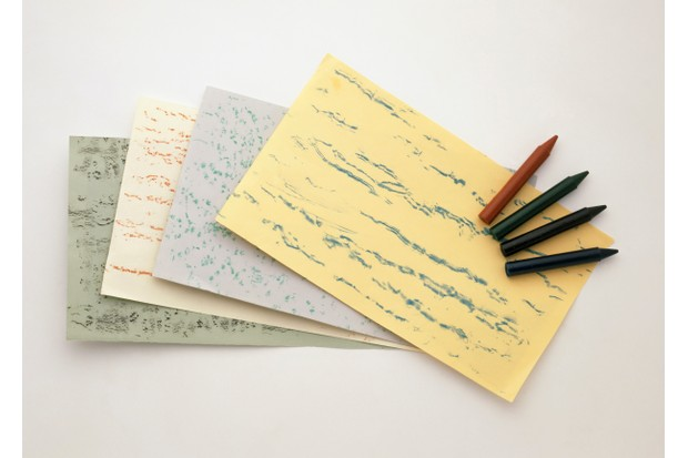 Four pieces of paper with tree rubbings on, and a set of crayons