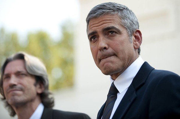 Actor George Clooney (L) and co-director of ENOUGH Project John Prendergast (L) speak to reporters at the White House after a meeting with US President Barack Obama about Sudan's referendum on October 12, 2010.         AFP PHOTO/Jim WATSON (Photo credit should read JIM WATSON/AFP/Getty Images)