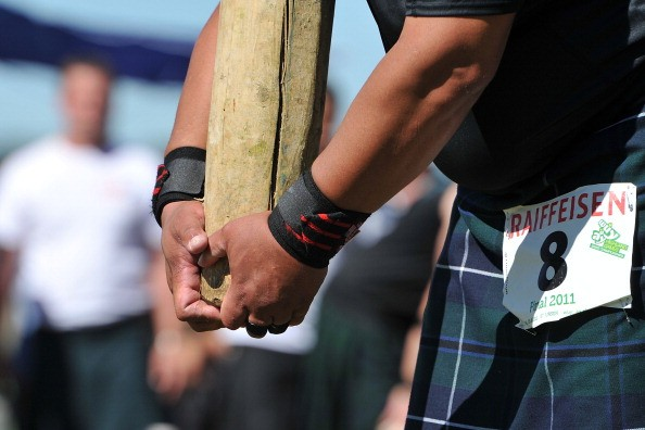 ST URSEN, SWITZERLAND - AUGUST 28:  A participant competes in the caber toss event during the 9th Swiss Highland Games on August 28, 2011 in St Ursen, Switzerland. The 9th edition of the Swiss Highland Games, which celebrates the Scottish and Celtic culture and heritage, will run this year from August 26 - 28.  (Photo by Harold Cunningham/Getty Images)