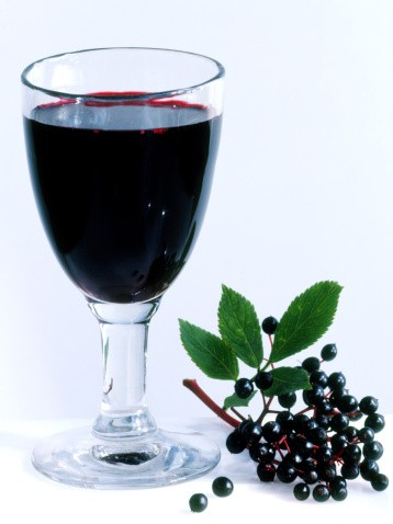 Glass of elderberry juice with fruit