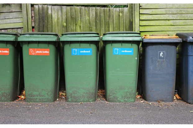 Ordered line of recycling bins for filtering rubbish.