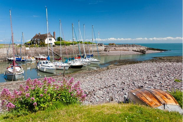 Boats in the outer harbour at Porlock Weir, Somerset England UK
