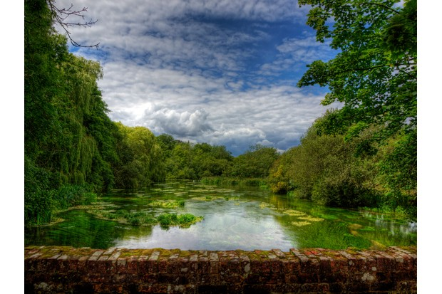 This is the River Itchen as it flows under an ancient brick at Itchen Stoke, near Winchester in Hampshire.