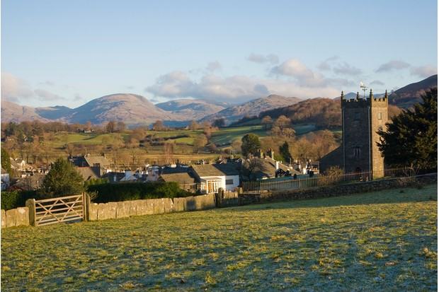 Hawkshead village in the English Lake District on a frosty winters morning with the fells in the background.
