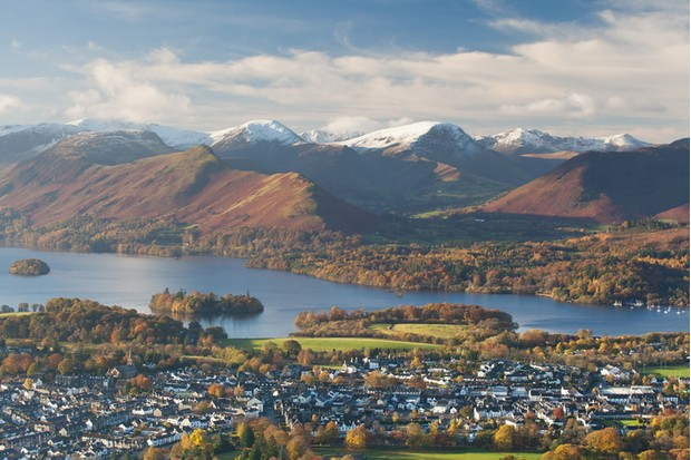 Classic view of Keswick, Derwent Water and the surrounding fells. Early cold spell led to a dusting of snow on the peaks while the last of the autumn colors covered the landscape around the lake.