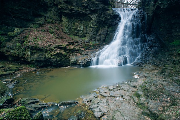 A long-exposure (6 minute) photograph of the waterfall at Hareshaw Linn, near Bellingham in Northumberland, England.