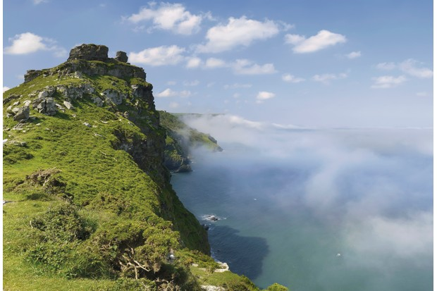the coast of the valley of the rocks lynton devon with sea fog against the cliffs