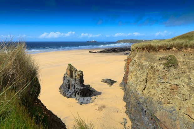 """coastal scenery at Gwithian with Godrevy lighthouse in the background; Gwithian, United Kingdom"""