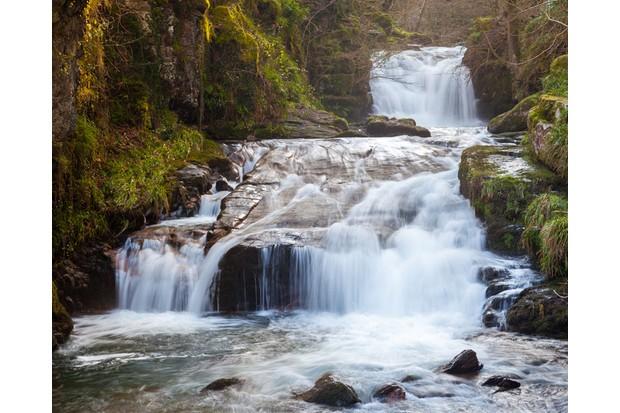 Watersmeet Falls, where the East Lyn River and Hoar Oak Water converge, Devon England UK