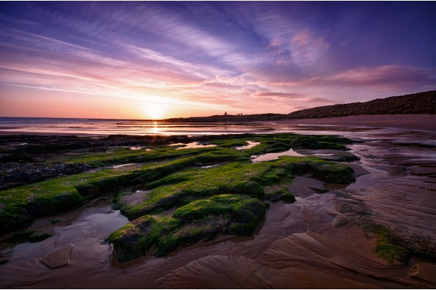 """Dunstanburgh Castle and Embleton Bay at Dawn, Northumberland UK"""