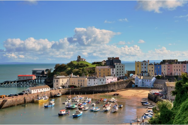 """""""Picturesque view of boats in Tenby Harbour, with its clusters of colourful painted houses, and Castle Hill"""""""