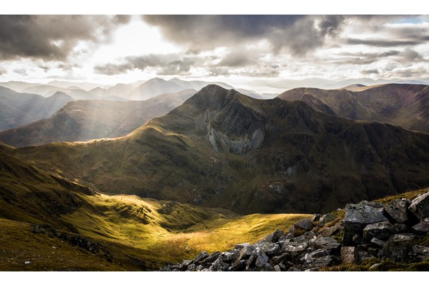 Stob Ban in Glen Nevis taken from Sgurr a'Mhaim with mid Autumn sun illuminating the glen below with layers of Glencoe mountains in the background.