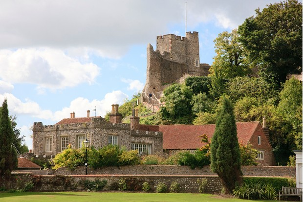View of Lewes castle and nearby buildings with the bowling green in the foreground