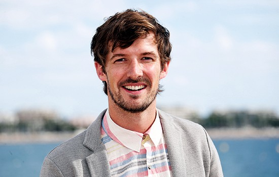 "British actor Gwilym Lee poses during a photocall for the TV series ""Midsomer murders"" as part of the Mipcom international audiovisual trade show at the Palais des Festivals, in Cannes, southeastern France, on October 7, 2013. AFP PHOTO / VALERY HACHE        (Photo credit should read VALERY HACHE/AFP/Getty Images)"