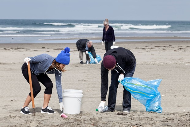 A group of volunteers picking litter from the beach