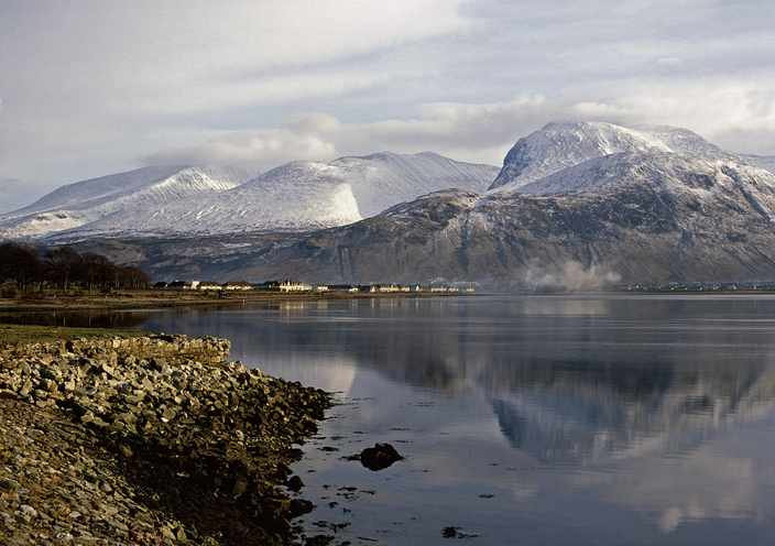The great bulk of Ben Nevis, UKs highest mountain at 4418 feet, towers above Fort William in Lochaber