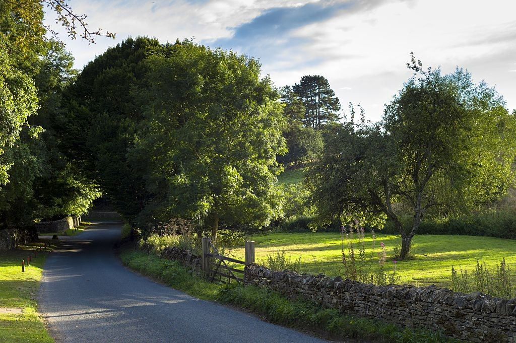 UNITED KINGDOM - SEPTEMBER 07: Country lane rural scene in Swinbrook in The Cotswolds, England, United Kingdom (Photo by Tim Graham/Getty Images)
