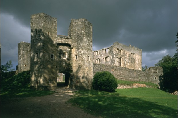 Berry Pomeroy Castle, Devon, 1995. Berry Pomeroy Castle combines a Tudor courtier's mansion within a 15th century castle. The gatehouse and curtain wall are part of the earlier castle, while the mansion with its many windows towers above the defences to the right. (Photo by English Heritage/Heritage Images/Getty Images)