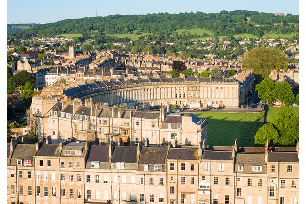 Evening view of Royal Crescent, a heritage street in the English city of Bath.
