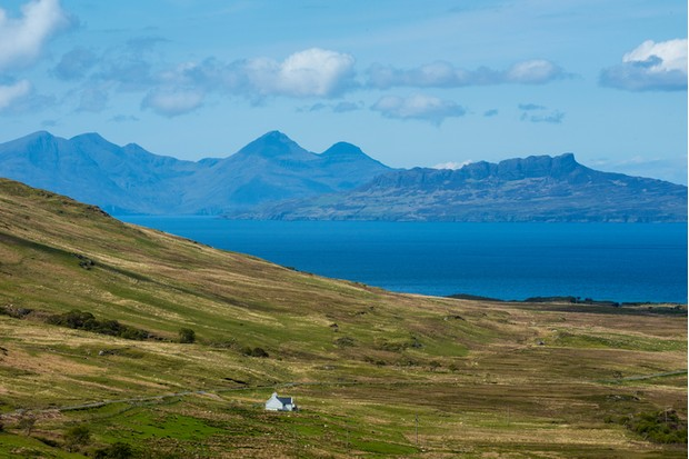 View over the inner hebridean islands of Eigg and Rum, Scottish Highlands, Scotland, UK