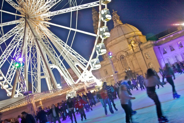 Wales, Cardiff - City Hall, winter, ferris wheel and ice rink.