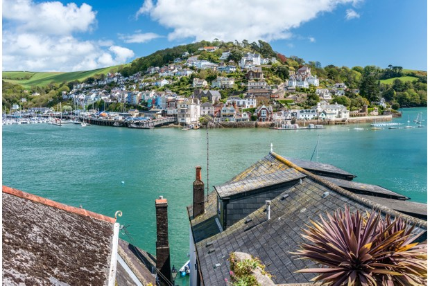 DARTMOUTH, DEVON, UNITED KINGDOM - 2015/05/09: (EDITORS NOTE: A polarizing filter was used for this image.) View at Harbor and Kingswear at the River Dart. (Photo by Olaf Protze/LightRocket via Getty Images)