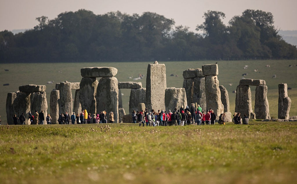 AMESBURY, ENGLAND - OCTOBER 13:  Visitors view the ancient neolithic monument of Stonehenge on October 13, 2015 in Wiltshire, England. The UK Government has announced today that it is committed to building a tunnel under the UNESCO listed ancient monument as part of a £2 billion spend on road projects in the South West of England between now and 2021 by Highways England.  (Photo by Matt Cardy/Getty Images)