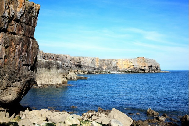 Rock cliffs on the coastline of the Trevallen Downs at St Govan's Head, Bosherston, Pembrokeshire, Wales, UK