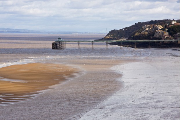 View of the Victorian pier at Clevedon in Somerset, UK. As well as providing access for promenaders it is still used as a landing stage in summer for passengers embarking on trips around the coastline and across the Bristol Channel to South Wales