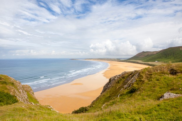 Rhossili Bay is the most westerly bay on the Gower peninsula in Wales, with a sandy beach three miles (5 km) long.