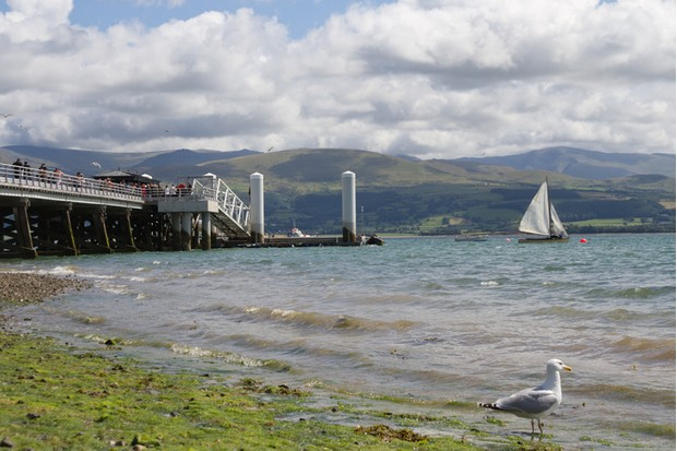 The pier at Beaumaris on the Menai strait which separates Angelsey from Wales.