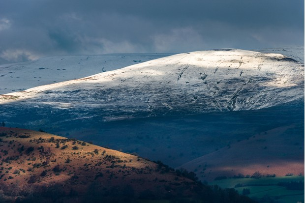 Telephoto landscape of the Black Mountains in the Brecon Beacons National Park. View from Llangynidr. February