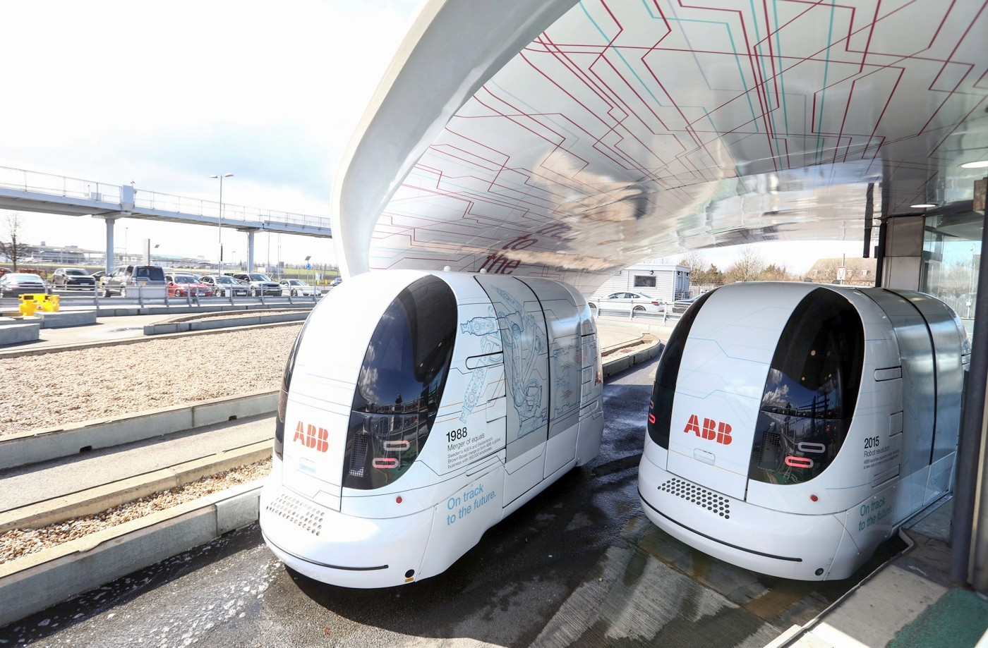 Self driving pods wait at a car park at Heathrow airport in London, U.K., on Tuesday, March 29, 2016. Some of the Ultra Global PRT Pods will be developed to take part in the GATEway (Greenwich Automated Transport Environment) Project and be tested on streets without dedicated tracks, according to a statement on the TRL Ltd. website. Photographer: Chris Ratcliffe/Bloomberg