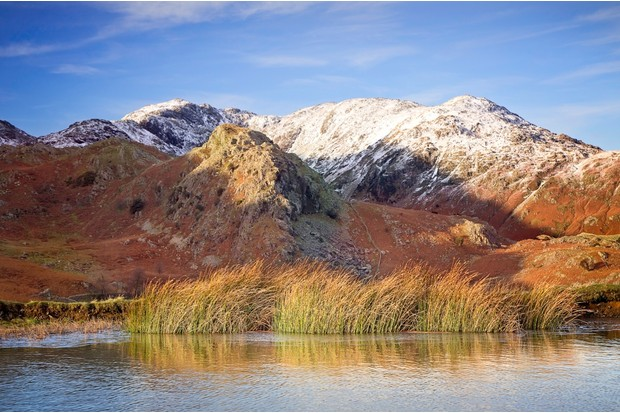 The Bell is the rocky outcrop in the foreground, with snow-covered Wetherlam and Old Man of Coniston behind