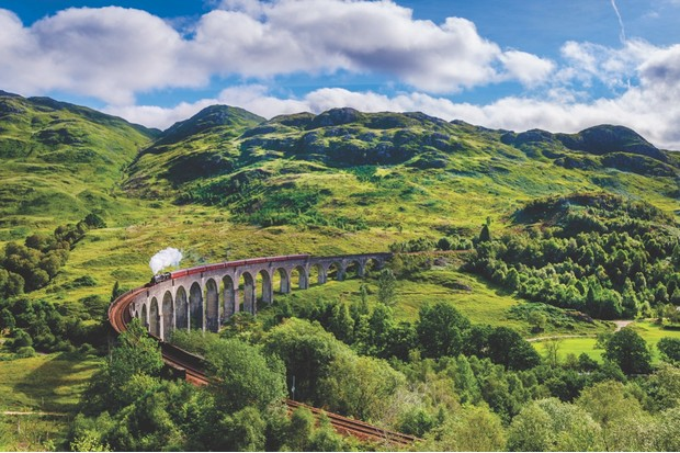 Steamtrain on the Glenfinnan Viaduct. This is the Viaduct that was used in the Harry Potter movies.