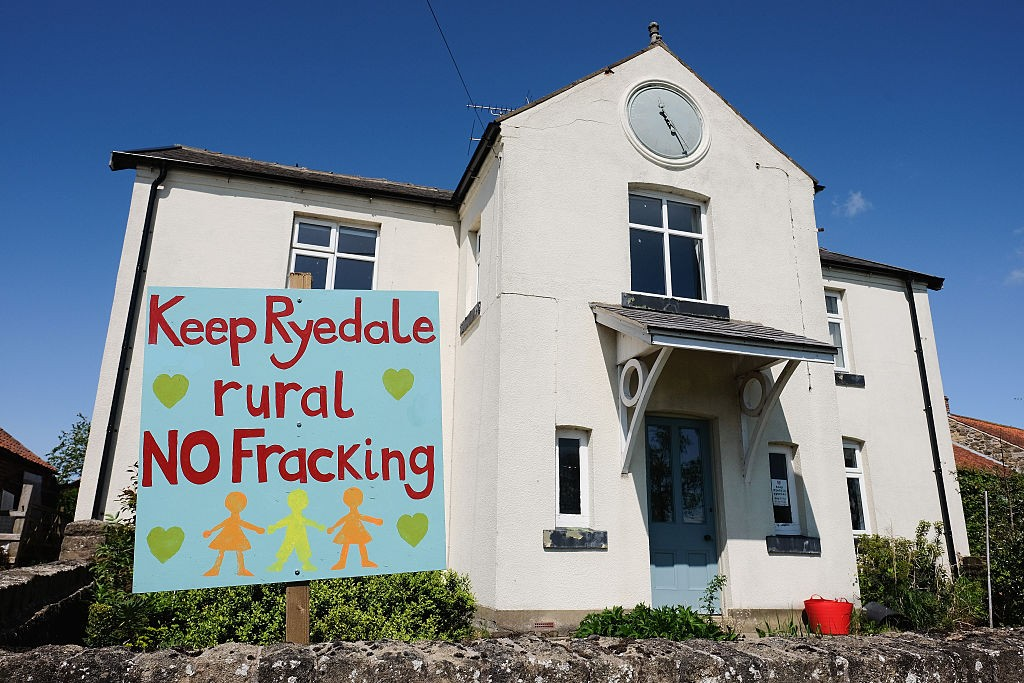 MALTON, ENGLAND - MAY 24: An anti fracking sign is displayed in the garden of a home on the outskirts to the village of Kirby Misperton on May 24, 2016 in Malton, England. North Yorkshire Planning and Regulatory Committee voted seven to four in favour of a planning application submitted by Third Energy to conduct fracking at the KM8 drilling site near the village. Hydraulic Fracturing, or fracking, is a technique designed to recover gas and oil from shale rock. (Photo by Ian Forsyth/Getty Images)