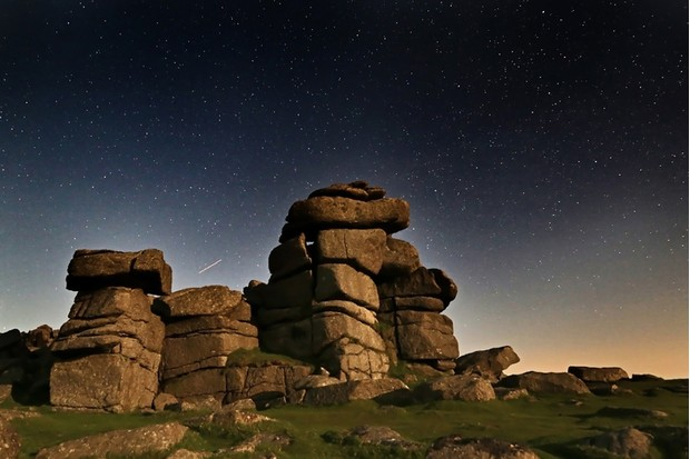 Various shots at Staple Tor on Dartmoor National Park at night with stars, in Devon UK