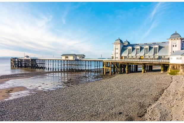 Penarth Pier and pebble beach in summer.