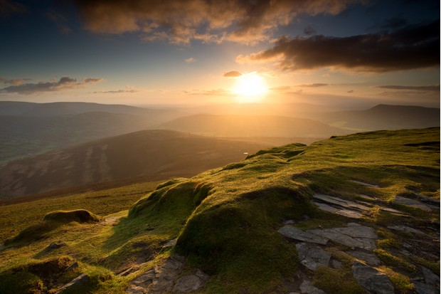 The summit of Sugar Loaf mountain, Mynydd Pen y Fal, in the Black Mountains, Brecon Beacons national park, Wales at sunrise.