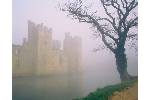 """Fog over Bodiam Castle and moat, Bodiam, Sussex, United Kingdom"""