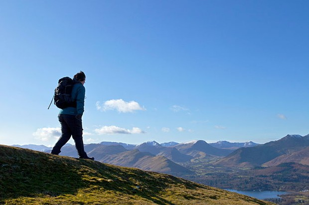 Walker descending a ridge in the Lake District National Park. (Photo by: Loop Images/UIG via Getty Images)