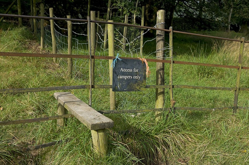 Access for campers only sign next to stile. (Photo by: Loop Images/UIG via Getty Images)
