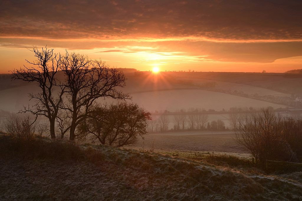 Sunrise over Hod Hill in Dorset.