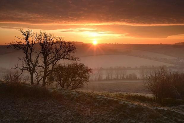Sunrise over Hod Hill in Dorset.