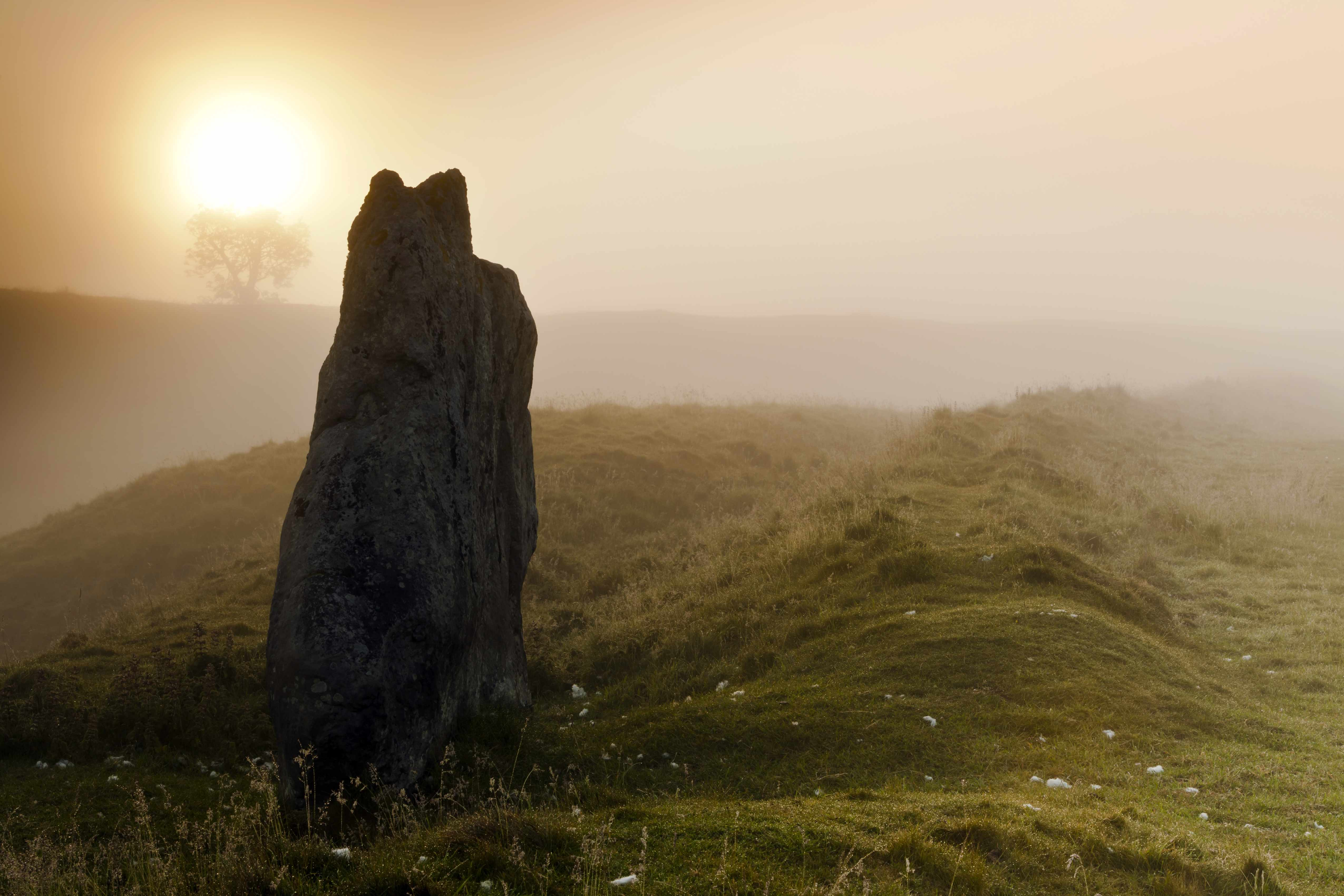 Dawn over a standing stone, part of the Avebury ring, the oldest stone ring known to be in existence in the world. (Photo by: Loop Images/UIG via Getty Images)