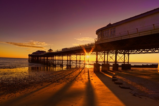 Cromer beach and Pier in Norfolk during a sunrise in the summer 2016