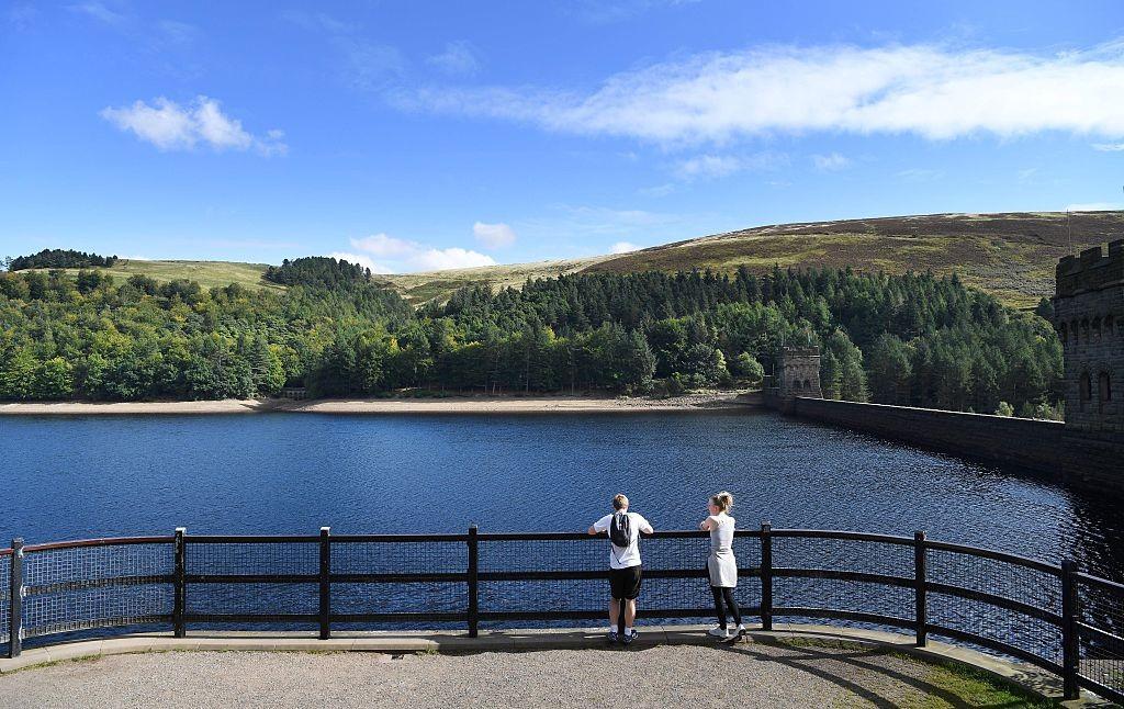 Visitors look out towards Derwent Dam at Derwent Reservoir in Derbyshire